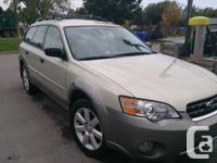 - 2006 Subaru Outback, manual transmission, this