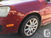 Make Volkswagen Model Jetta Year 2006 Colour Red kms