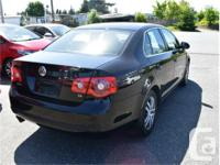 Make Volkswagen Model Jetta Year 2006 Colour Black kms