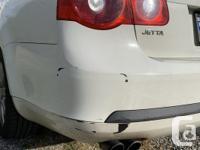 Make Volkswagen Model Jetta Colour White Trans