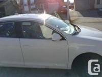 Make Volkswagen Model Jetta Year 2006 Colour White kms