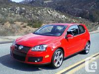 2006 Volkswagen GTI 2.0T Red exterior with grey sports