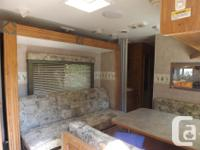25 foot Rear Kitchen with Slide out couch/bed. Dinette
