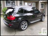 Make BMW Model X5 Year 2007 Colour Black with Tan