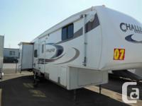 Features:  Triple Slide Toppers, Roof AC, Skylight