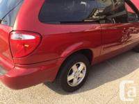 Make Dodge Model Grand Caravan Colour Red Trans