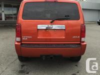 Make Dodge Model Nitro Year 2007 Colour Orange kms