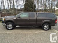 2007 ford f150 lariat with the 5.4 triton v8. Only 62