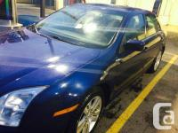Make Ford Model Fusion Year 2007 Colour blue kms