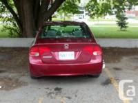 Make Honda Model Civic Year 2007 Colour burgundy kms