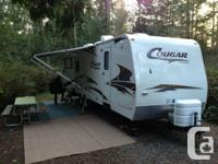 2007 Keystone Cougar 294RLS. Standard features include