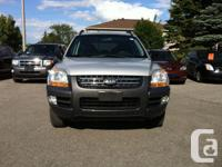 Make Kia Model Sportage Year 2007 Colour Silver kms