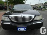 Black with 8 cylinder automatic transmission, air-con,