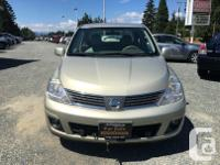 Make Nissan Model Versa Year 2007 Colour Brown kms