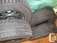 2007 Subaru Outback snow tires with rims, Toyo