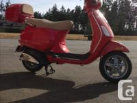 I am selling my 2007 Vespa LX 150 in dragon red for
