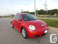 I have a red 2007 Volkswagen Beetle in superb