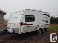 Very clean 19ft Antigua Hybrid Camper. Beds tip out the