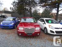 Make Chrysler Colour red Trans Automatic kms 128000