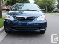 BLUE COROLLA FO SALE.5 SPEED MANUAL TRANSMISSION,