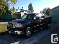 2008 Ford F150 SuperCrew XLT Black 4X4 short box truck.