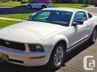 2008 V6 ford mustang. White body with black accents on