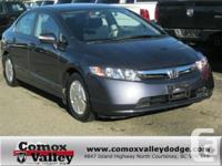This sporty 2008 Honda Civic Hybrid has features such