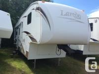 This back lounge Laredo fifth wheel has all the storage