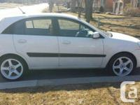 """I am selling my white 2008 Kia Rio5 """"AS IS"""". It is a"""