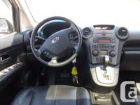 Trans Automatic This 2008 Kia Rondo EX comes with alloy