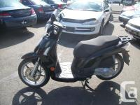2008 Kymco People S 125. Looks sharp in black with