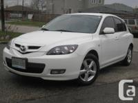 Sporty white Mazda 3 (hatchback) in excellent condition