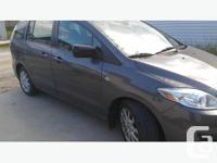 This Mazda Mazda5 minivan will be the perfect fit for