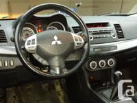 Make Mitsubishi Model Lancer Year 2008 Colour Silver