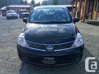 Make Nissan Model Versa Year 2008 Colour Black kms