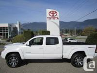 This Double Cab Tacoma has aftermarket alloy wheels and