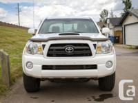 Make Toyota Model Tacoma Colour White Trans Manual kms