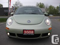 Make Volkswagen Model New Beetle Year 2008 Colour Gecko