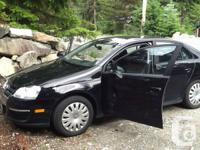 Black 4 door Jetta Trendline, 2.5 Litre engine for