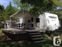 Excellent condition travel trailer parked at