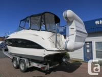 2009 BAYLINER 265 CRUISER. This beautiful boat comes