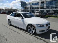 Make BMW Colour WHITE Trans Automatic kms 149000 2009