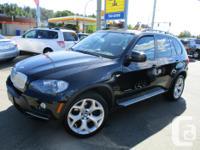 Make BMW Model X5 Year 2009 Colour black kms 145000