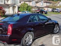 Make Cadillac Model CTS Year 2009 Colour Black cherry