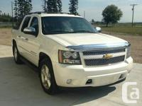 Selling my 2009 Pearl White Chevy Avalanche
