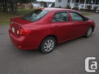 Make. Toyota. Version. Corolla. Year. 2009. Colour.