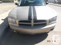 Make Dodge Model Charger Year 2009 Colour gold kms