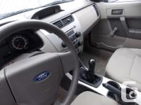 This 2009 Ford Focus S comes with AM/FM radio, CD