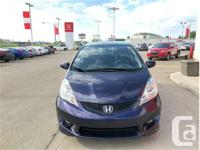 Make Honda Model Fit Year 2009 Colour Purple kms 82670