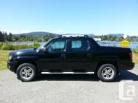 Make Honda Model Ridgeline Year 2009 Colour Black kms